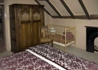 Cot in one of the double bedrooms