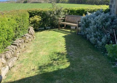 Side Garden with sea views at Holly Cottage, Boggle Hole
